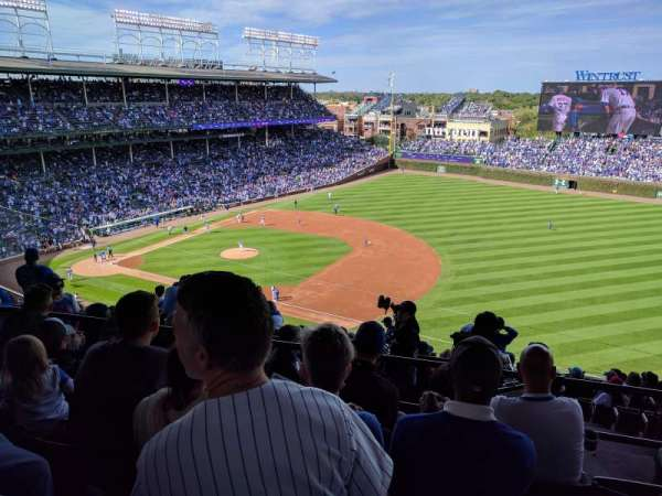 Wrigley Field, section: Upper Reserved Outfield aisle , row: 4, seat: 106