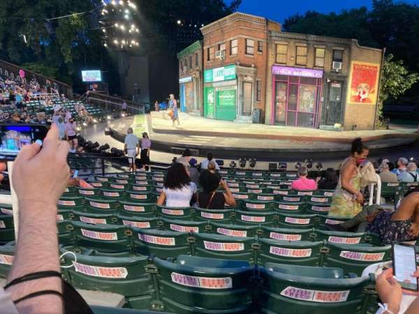 The Delacorte Theater in Central Park, section: G, row: M, seat: 207