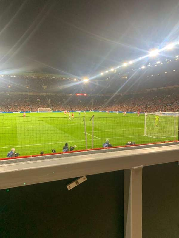 Old Trafford, section: E134, row: RR, seat: 129