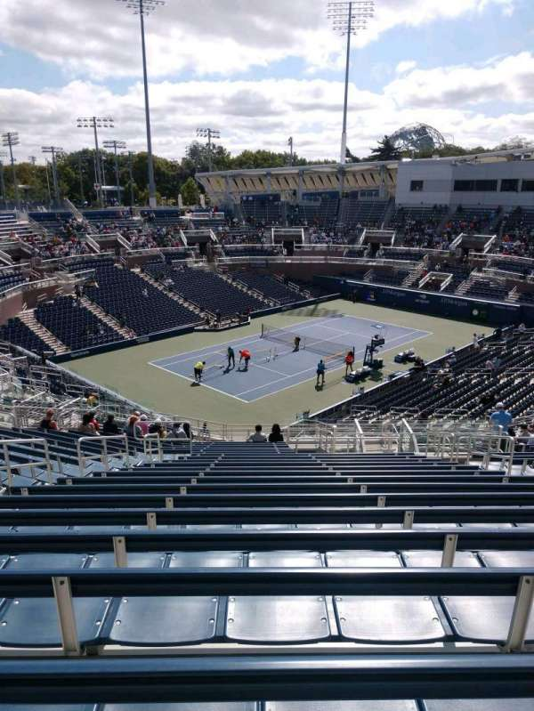 Billie Jean King National Tennis Center, Grandstand, section: F, row: V, seat: 8