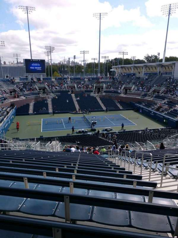 Billie Jean King National Tennis Center, Grandstand, section: I, row: X, seat: 6