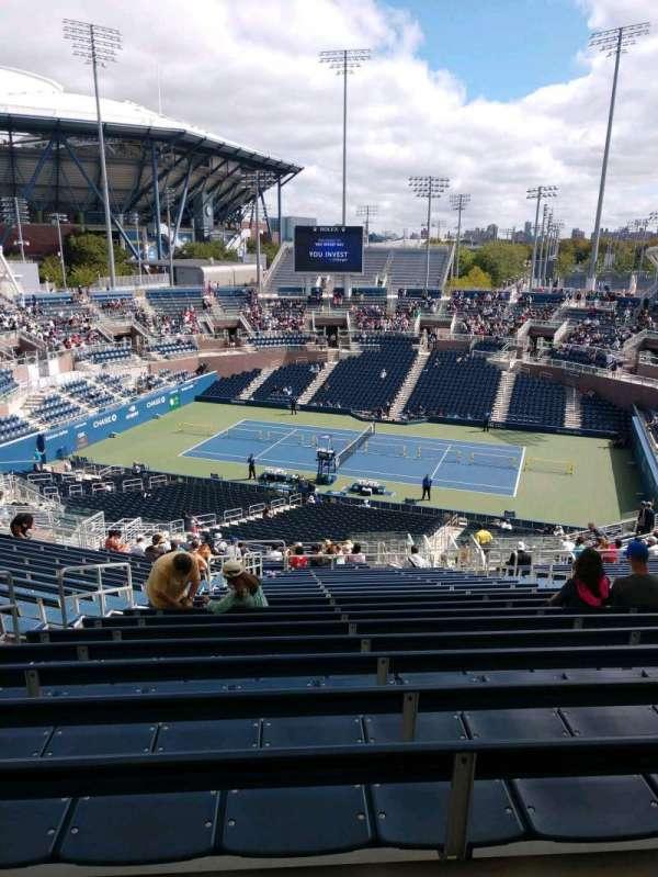 Billie Jean King National Tennis Center, Grandstand, section: L, row: V, seat: 7