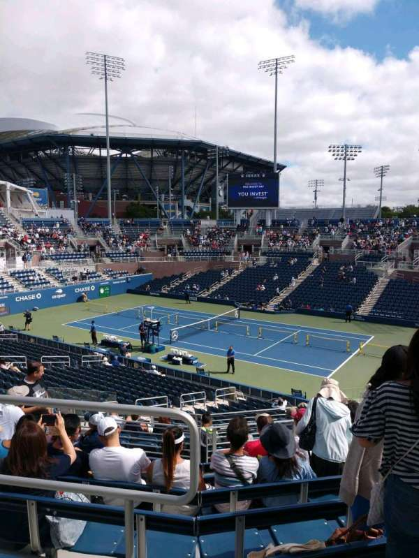 Billie Jean King National Tennis Center, Grandstand, section: N, row: H, seat: 1
