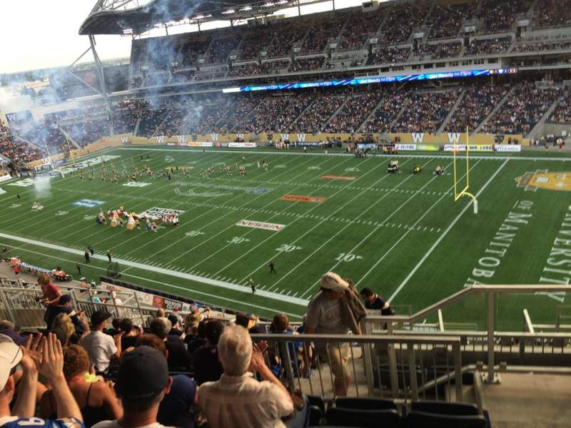 Seating view for Investors Group Field Section 203 Row 18 Seat 1