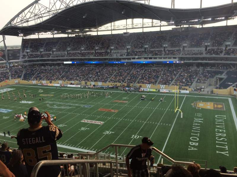 Seating view for Investors Group Field Section 203 Row 19 Seat 20