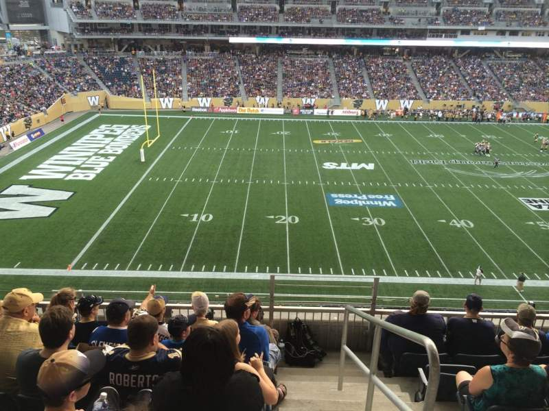 Seating view for Investors Group Field Section 211 Row 6 Seat 1